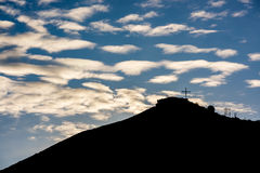 Beautiful morning clouds with a religious cross on moutnain Stock Images