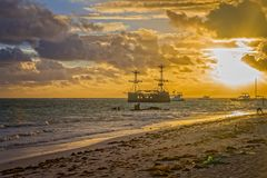 Sunrise on the Atlantic ocean. Beautiful morning landscape with caravel near coast in Punta Cana. Dominican Republic Royalty Free Stock Photo
