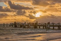 Sunrise on the Atlantic ocean. Beautiful morning landscape with wooden pier in Punta Cana. Dominican Republic Stock Photos