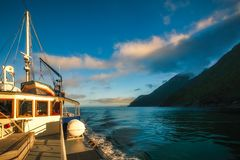 Beautiful morning light on a cruise at Milford Sound. Beautiful light early in the morning on a cruise at Milford Sound Fjord close to the Tasman Sea in Royalty Free Stock Photography