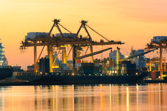 Beautiful of morning light in ship port loading container goods Royalty Free Stock Images