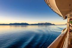 Beautiful morning light and water ripples from ship`s wake, Alaska, USA. royalty free stock photos