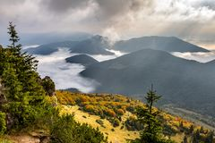 Beautiful morning mountain landscape with low clouds in valley Royalty Free Stock Images