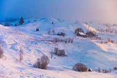 Beautiful morning in mountainous countryside. Winter landscape at sunrise royalty free stock photos