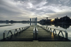 Beautiful morning near the lakeside, modern building and wooden jetty Stock Photos