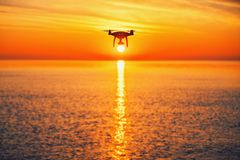 Beautiful morning over the sea and flying drone Stock Photo