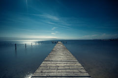 Beautiful morning over wooden pier Royalty Free Stock Image