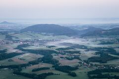 Beautiful morning panorama from Ondřejník of Beskydy mountains. Thick fog hangs between the hills. A cold morning accompanied by