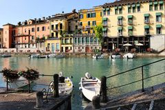 Beautiful morning in Peschiera del Garda town. Colorful houses, architecture view with boats. Little town harbour. Italian lake lago di Garda, Veneto region of royalty free stock images