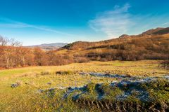 Beautiful morning scenery with hoar on the grass. Lovely autumn countryside in mountains. beautiful morning scenery with hoar on the grass and bright blue sky stock photo