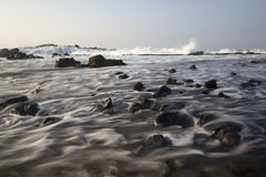 Flowing Wave at Beach Stock Image