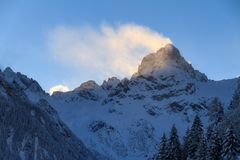 Backlit snow mountain top in the Brandnertal stock image