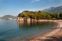 Beautiful morning view of the beach near Budva,Montenegro. Beautiful morning view of a pebble beach with clear water near Budva, Montenegro royalty free stock images