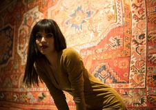 Beautiful Moroccan Girl in Short Golden Dress in Rich Mosaic interior of Picturesque Dar Si Said Riyad in Marrakech.  stock photos