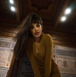 Beautiful Moroccan Girl in Short Golden Dress in Rich Mosaic interior of Picturesque Dar Si Said Riyad in Marrakech.  stock image