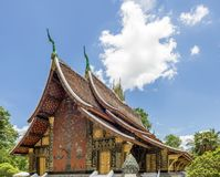 The beautiful mosaic `The Tree of Life` in the famous Wat Xieng Thong temple of Luang Prabang, Laos royalty free stock image