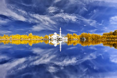 Beautiful mosque by the lakeside viewed in infrared Stock Photo