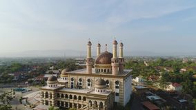 Mosque in indonesia. Beautiful mosque with minarets on island Java Indonesia. aerial view mosque in an asian city stock video