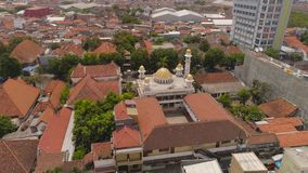 Mosque in indonesia. Beautiful mosque with minarets in surabaya on island Java Indonesia. aerial view mosque in an asian city stock footage