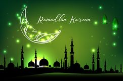 Beautiful mosque with moon on green sky background Stock Photo