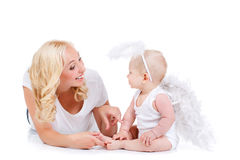 Beautiful mother with the angelic child. Stock Photos