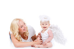 Beautiful mother with the angelic child. Royalty Free Stock Photos