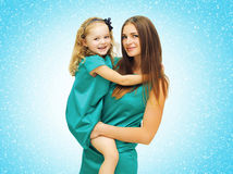 beautiful mother and baby in dress embracing Stock Image