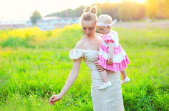 Beautiful mother and baby little daughter wearing a dress Royalty Free Stock Photos