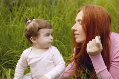 Beautiful mother and baby little girl outdoor Royalty Free Stock Images