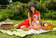 Beautiful mother and baby on nature Stock Images