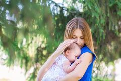 Beautiful mother and baby outdoor. Royalty Free Stock Photo