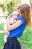 Beautiful mother and baby outdoor. Stock Photo