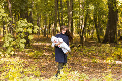 Beautiful Mother And Baby outdoors. Beauty Mum and her Child playing in Park together. Royalty Free Stock Photography