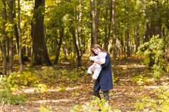 Beautiful Mother And Baby outdoors. Beauty Mum and her Child playing in Park together. Royalty Free Stock Photos