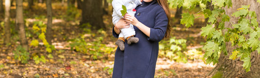 Beautiful Mother And Baby outdoors. Beauty Mum and her Child playing in Park together. Stock Photo
