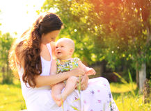 Beautiful Mother And Baby outdoors. Royalty Free Stock Photos