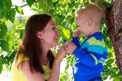 Beautiful Mother And Baby outdoors. Nature Stock Photos