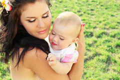 Beautiful mother with baby, outdoors portrait Royalty Free Stock Photos