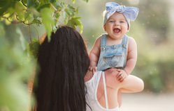 Beautiful mother and baby outdoors in summer Park Royalty Free Stock Images