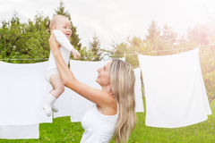 Beautiful mother and baby playing together outdoors Royalty Free Stock Images