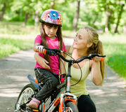 Beautiful mother calms the sad daughter who did not get to ride Stock Photography