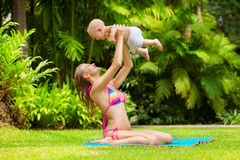Beautiful mother and child in the open air. Nature. Outdoor port Royalty Free Stock Photo