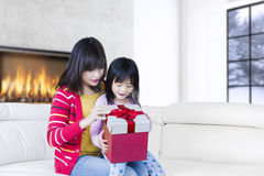 Beautiful mother and child open gift box Stock Images