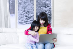 Beautiful mother and child use laptop Stock Photos