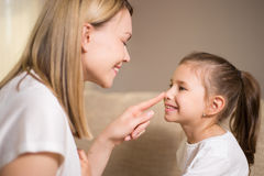 Beautiful mother is comforting his young frustrated daughter. Stock Images
