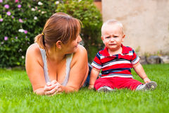 Beautiful mother and crying toddler boy outdoors Stock Photography