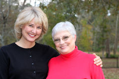 Beautiful mother and daughter. A pretty elderly woman and her beautiful daughter royalty free stock photo