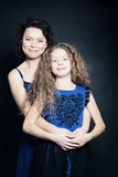 Beautiful Mother and Daughter Embracing Stock Images