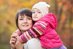 Beautiful mother with daughter girl outdoors in fall Royalty Free Stock Photos