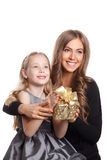 Beautiful mother and daughter holding a present Royalty Free Stock Photo